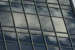 Skyscraper reflecting the sky Stock Photos