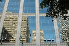 Skyscraper reflections. Modern skyscrapers reflected on urban windowed building Royalty Free Stock Photos