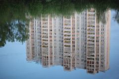 Skyscraper reflexion in water. Spring Royalty Free Stock Images