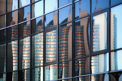 Skyscraper reflexion in windows. Buildings reflected in windows of modern office building Royalty Free Stock Photos
