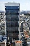 Afternoon Skyscraper. Skyscraper rising above Herzel street in Tel-Aviv, Israel; its windows reflecting more of the urban surroundings Royalty Free Stock Images