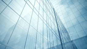 Skyscraper's blue glass walls Royalty Free Stock Photography