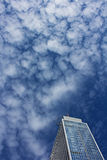 Skyscraper in the Sea of ​​Clouds Stock Images