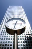 A skyscraper and street clocks Stock Image