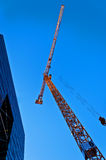 Skyscraper with tower crane. On sky background Stock Images