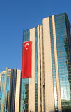 Skyscraper with a turkish flag in istanbul Stock Photography
