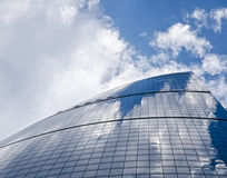 Skyscraper. Under blue sky and white clouds Royalty Free Stock Photo