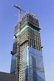 Skyscraper under construction in Beijing city center, China. BEIJING–APRIL 13, 2012. Skyscrapers under construction on April 13, 2012. China has a booming Royalty Free Stock Photo