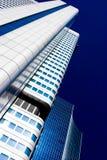 Skyscraper vanishing in blue sky Royalty Free Stock Image