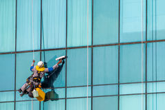 Skyscraper window cleaner. Window cleaner working on high-rise building in Dubai Royalty Free Stock Image