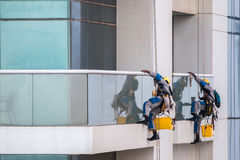 Skyscraper window cleaners. Window cleaners working on high-rise building Stock Photo