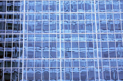 Skyscraper windows pattern. Detailed window pattern of a midtown NYC skyscraper. Skycrapers are symbols of econmic power Royalty Free Stock Images