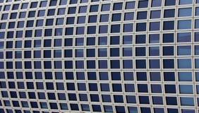 Skyscraper windows pattern. Regular pattern of a modern building wall of windows Stock Photo