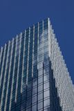 Skyscraper windows reflecting Clouds royalty free stock photo