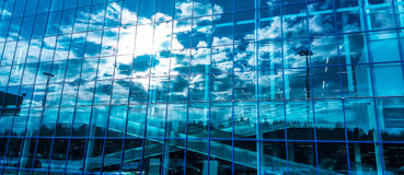 Skyscraper windows with reflection of the sky. Modern buildings Royalty Free Stock Photo