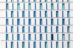 Skyscraper with windows structured in rows with differ Royalty Free Stock Images