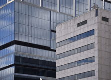 Skyscraper Windows and walls. Glass and steel skyscrapers with reflections of sky Stock Image