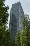 A Skyscraper Through The Woods. A Picture of a Skyscraper in London shot through the trees of a nearby park royalty free stock image