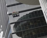 Skyscraper Workers. Not only risk fatal fall, other equipment can also fail and cause injuries Stock Photos