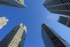 Skyscrapers. Shot from underneath againsty bright blue sky Stock Images