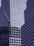 Skyscrapers. Tinted blue skyscrapers w/ reflection of a crane Royalty Free Stock Photos