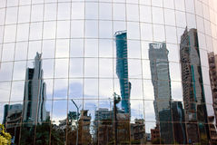 Skyscrapers. Reflection of skyscrapers in the windows of the modern office building Stock Image