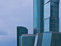 Skyscrapers. Modern office building on a cloudy sky background stock photography