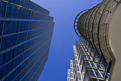 Skyscrapers against a blue sky. Two skyscrapers against the blue sky. Clear sky. Picture taken from bottom looking straight up Royalty Free Stock Images