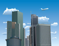 Skyscrapers against blue sky with white clouds Royalty Free Stock Images