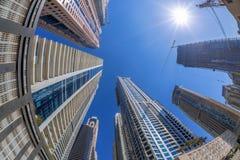 Skyscrapers against sunshine by fisheye in Dubai, United Arab Emirates Stock Photo