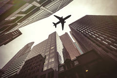 Skyscrapers and airplane. Air safety. A plane flies at low altitude just above the roofs of skyscrapers of a modern city. Travel safe. Location: Toronto, Canada Royalty Free Stock Photo