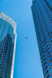 Skyscrapers and airplane Stock Photos
