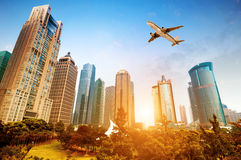 Skyscrapers and airplanes Stock Images