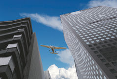 Skyscrapers and airplanes on sky. Royalty Free Stock Images