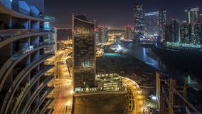 Buildings on Al Reem island in Abu Dhabi night timelapse from above. Skyscrapers on Al Reem Island in Abu Dhabi night timelapse from above. Aerial citiscape stock video