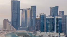 Buildings on Al Reem island in Abu Dhabi timelapse from above. Skyscrapers on Al Reem Island in Abu Dhabi timelapse from above. Aerial citiscape from Al Reem stock footage