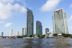 Skyscrapers along river in Bangkok Stock Images