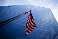 Skyscrapers with American flag Stock Image