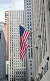 Skyscrapers and the American flags Stock Photography