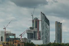 Free Skyscrapers And Construction Cranes Clutter The Horizon Stock Images - 137229754