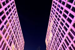 Skyscrapers with beautiful illumination in the evening Stock Photos