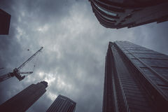 Skyscrapers from below with dramatic sky Stock Photography