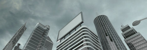 Skyscrapers & billboard. Business district and billboard under gray clouds Stock Photography