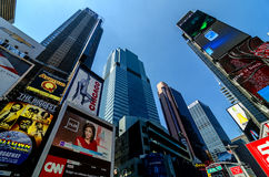 Skyscrapers, Billboards and Signs of Times Square along Broadway. Scene featuring the numerous neon signs, billboards, skyscrapers and other commercial Stock Image