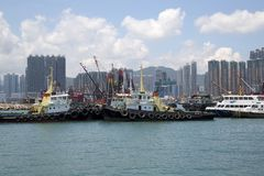 Group skyscrapers and boats in pier Hongkong royalty free stock photos