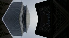 Skyscrapers building view from below in Frankfurt Germany Architecture. With mirror effect stock images