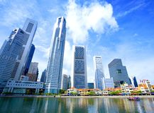 Skyscrapers in business district of Singapore. Tall and modern skyscrapers in business district of the city of Singapore Stock Photo