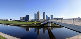 Skyscrapers in center of Vilnius. And walking bridge over river Neris Royalty Free Stock Photography