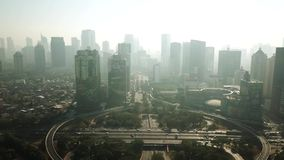 Skyscrapers in Central Business District of SemanggiScenery of office buildings and Semanggi bridge. JAKARTA, Indonesia. September 14, 2017: Beautiful aerial stock footage