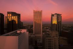 Skyscrapers in central Phoenix in sunrise light. Phoenix, ARIZONA - October 21 2017: Skyscrapers in central Phoenix in red sunrise light. View from the 22nd stock image